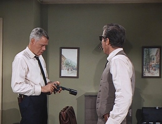 """Charlie Strom checks his """"suppressed"""" Smith & Wesson Model 27 before leaving to confront Jack Browning. Note the Single Action Army holstered in his back trouser pocket."""