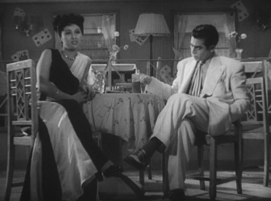 Matsunaga entertains his date, Yakuza moll Nanae (Michiyo Kogure).
