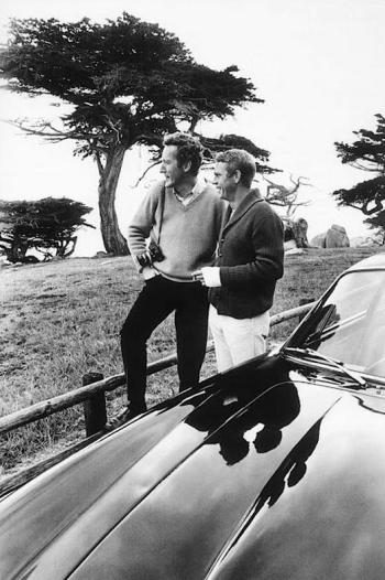 William Claxton, camera in hand, stands with then-pal and frequent subject Steve McQueen in California, 1964.