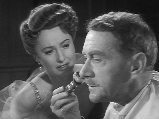 Julia (Barbara Stanwyck) pleads with an indifferent Richard.