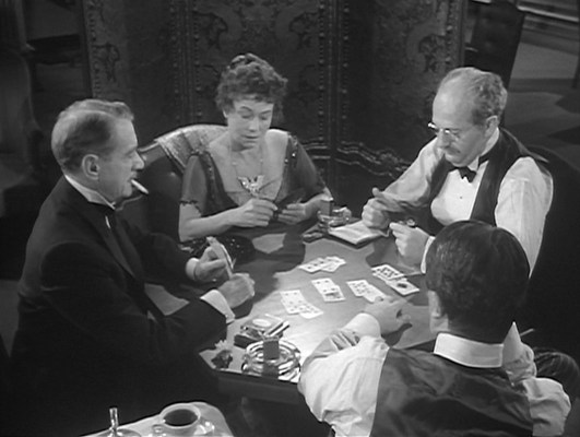 In the first-class smoking lounge, Richard does just what the room was made for during a high-stakes poker game with Maude Young (Thelma Ritter), George Widener (Guy Standing Jr.), and Earl Meeker (Allyn Joslyn). Though Maude is inspired by the real life passenger Margaret