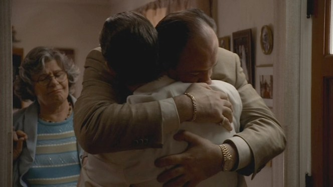 """""""Tony Uncle Johnny"""" embraces """"Tony Uncle Al"""" while the latter's mother, Quintina (Rae Allen), looks on."""