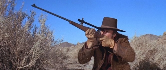 After decades of the all-American Winchester lever-action rifle ruling the West, it's quite a difference to see a Clint Eastwood shouldering a Canadian-made rifle developed after a dispute with the English over a war in South Africa.