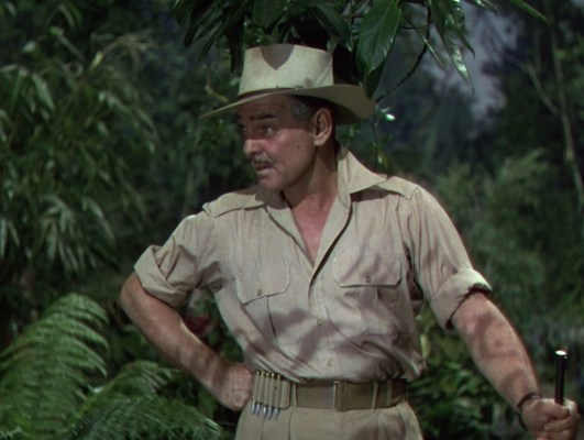 Victor on safari with his wide-brimmed hat, bush shirt, and belt equipped with a five-round ammo carrier.