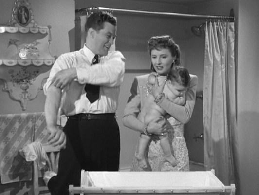 Jones eagerly rolls up his sleeves to help Robert- er, Roberta with her bath.