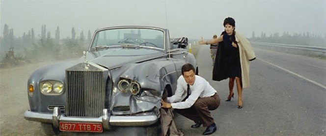 Poor Renzo is forced to put his suit jacket into service to hope to salvage Anna's wrecked Rolls.