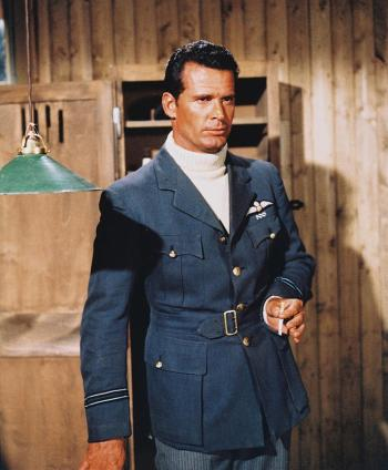 "Production photo of James Garner wearing Flight Lieutenant Hendley's RAF uniform tunic and turtleneck, though his trousers are the striped trousers that match his ""escape suit""."
