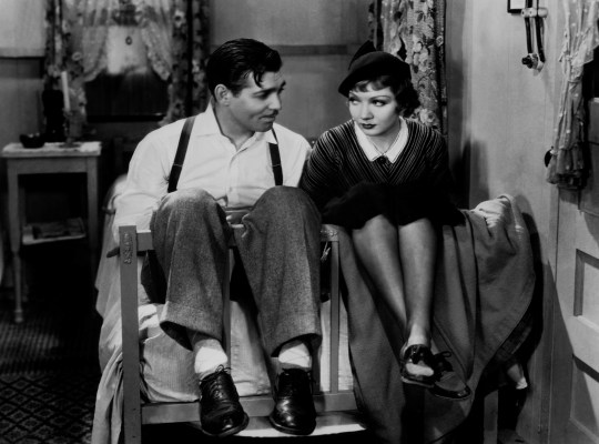 Promotional photo of Clark Gable and Claudette Colbert in It Happened One Night (1934).