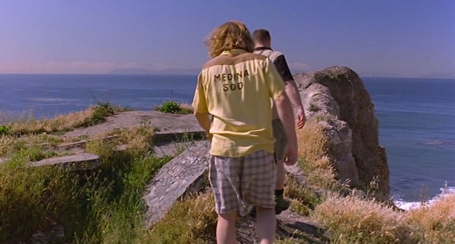 The Dude and Walter step off the Sunken City trail in San Pedro to scatter Donny's ashes in the wind.