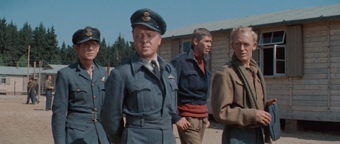 """Robert Desmond, Richard Attenborough, James Coburn, and Gordon Jackson in The Great Escape (1963). Desmond played Flying Officer Griffith, a fictionalized version of the real camp """"tailor"""", Tommy Guest."""