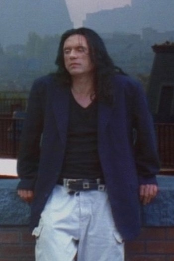 Tommy Wiseau as Johnny in The Room (2003)