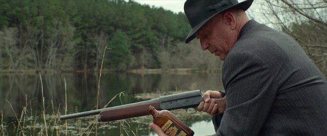 Remington riot gun in hand, Hamer finds a discarded bottle of Hiram Walker's Royal Oak whiskey... remnants of the Barrow gang's last campsite.