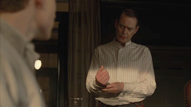 "Nucky snaps his cuff links together while talking with his nephew in ""The Old Ship of Zion"" (Episode 4.08)."