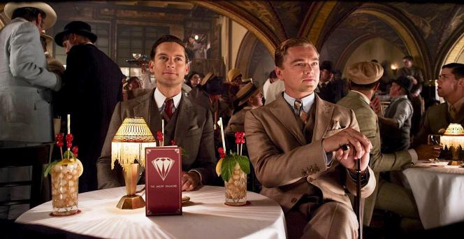 "Nick Carraway (Tobey Maguire) and Jay Gatsby (Leonardo DiCaprio) are treated to exotic-looking highballs during their ""lunch"" in this production photo from The Great Gatsby (2013)."