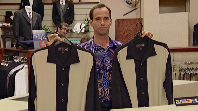 Larry buys the remaining stock of black-and-cream Nat Nast shirts from Caruso's.