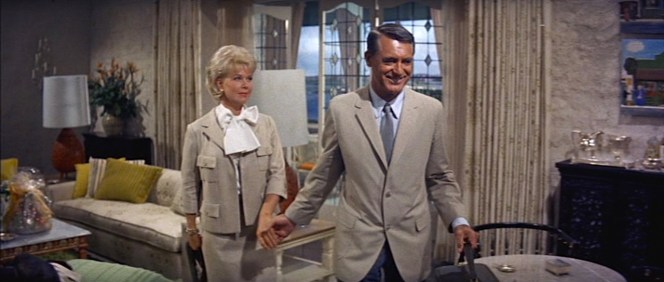 Beige has been Cathy's signature color up to this point inThat Touch of Mink, and Philip matching her with his summer sports coat shows that they're truly in sync for the first time in the movie, particularly as she is outfitted in the new Bergdorf Goodman suit that Philip paid for and coordinated with the help of the laconic Leonard.