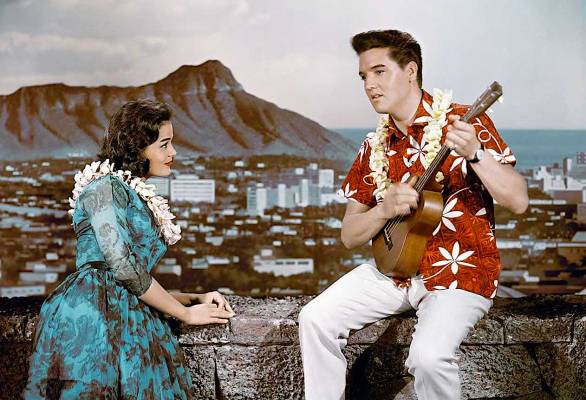 Promotional photo of Elvis with Joan Blackman, who played Chad's girlfriend Maile in Blue Hawaii. Photos from this session were used to promote the soundtrack and the movie itself despite this shirt not being worn in the final cut.