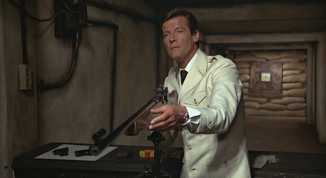 Bond's distinctive cocktail cuff emerges from the sleeves of his jacket as he coolly interrogates Lazar.