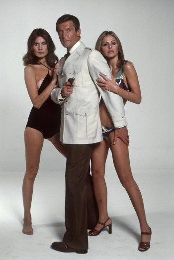 Promotional photo of Maud Adams, Roger Moore, and Britt Ekland in The Man with the Golden Gun. As these three costumes never appear together on screen, it's evident that whoever directed the shoot wanted to convey the warmth of the film's subtropical setting.