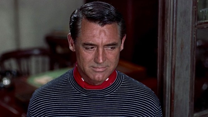 Robie keeps a cautious eye on the suspicious staff at Bertani's restaurant. Hitchcock's masterful cinematographer Robert Burks photographed Cary Grant from above for much of this scene, evoking a security camera and thus suggesting that we the audience are as suspicious of Robie as the rest of the restaurant staff.
