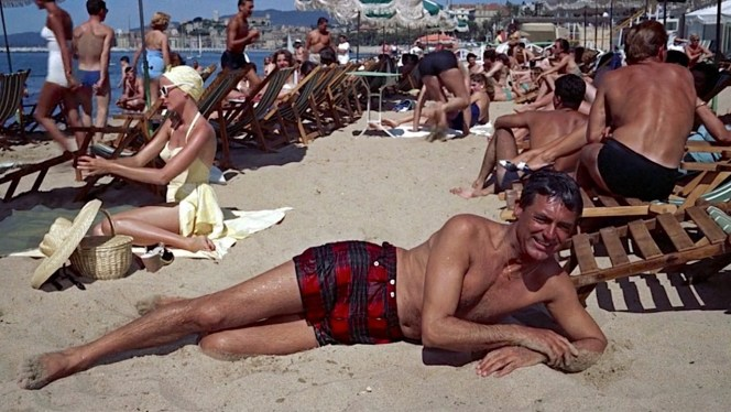 John Robie picked one leisurely way to make his getaway, reclining on the beach at Cannes after emerging from the waves.