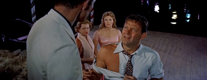 "New York Times critic Stephen Holden (no relation to William) commented in 1996 that, ""in 1955, the 'Moonglow' dance and the 'torn shirt' sequences from the movie Picnic were about as steamy as Hollywood could get in evoking explosive sex."""
