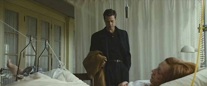 Benjamin looks both somber yet slick and youthful for his visit to Daisy's hospital bed.