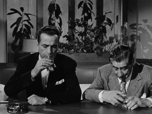 Dix and Charlie, deep in their gin and brandy, respectively.