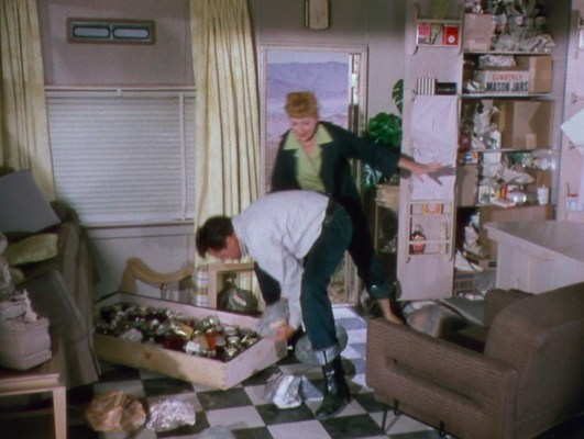 In a furious (and actually reasonable) state of rage, Nicky tosses out the heavy collectables that Tacy had secretly stored away.