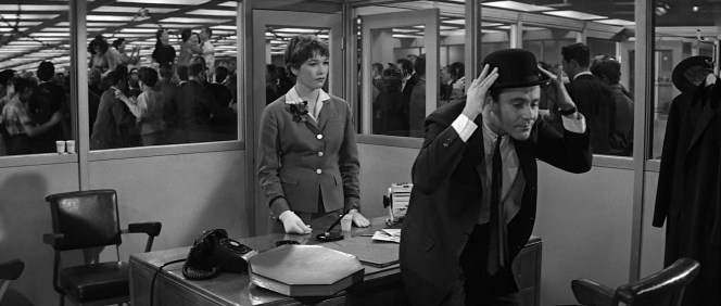 C.C. Baxter models his latest fineries for an unenthused Miss Kubelik.