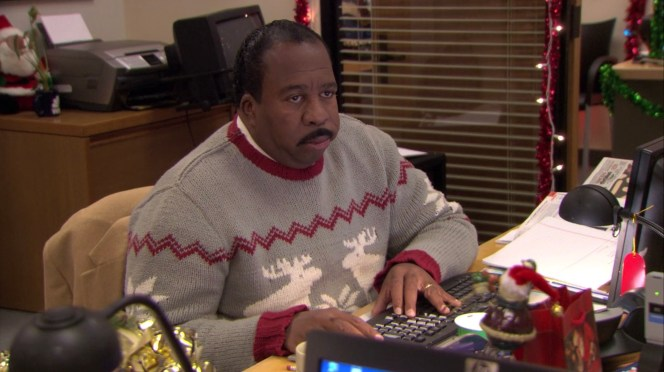 Stanley looks just as excited to be wearing that sweater as one would expect.
