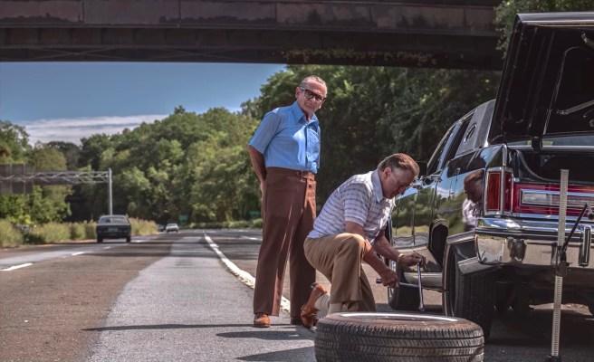 Production still of Joe Pesci as Russell Bufalino overseeing Frank Sheeran's (Robert De Niro) effort to change a flat tire on his Lincoln.