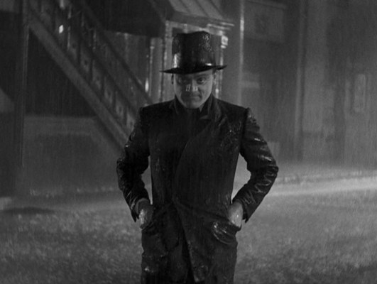 After his determined stride into the joint, Tom would emerge from the gunfight with his suit, body, and pride torn apart as the wounded gangster wildly flails in the rain like a twisted take on Gene Kelly's ebullient dance in Singin' in the Rain before landing in the gutter.