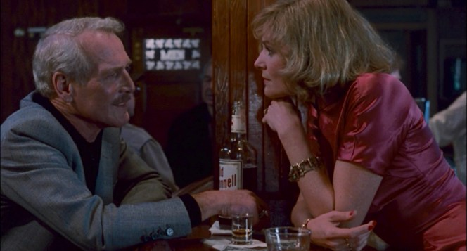 Eddie introduces Janelle to the virtues of the fictional Old McDonnell bourbon.