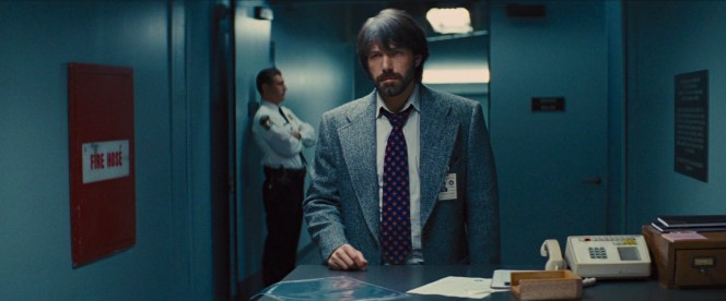 Mendez sticks to his tweed when back at CIA headquarters after a job well done.