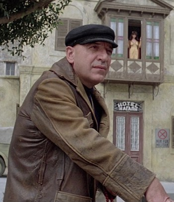 Telly Savalas as Zeno in Escape to Athena (1979)
