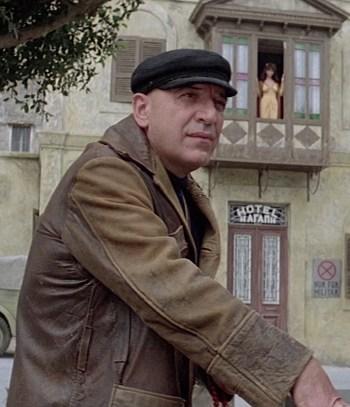 Telly Savalas as Zeno in Escape to Athena (1979)