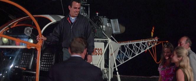 Jim wears a navy Baracuta G9 not unlike Steve McQueen wore in The Thomas Crown Affair.