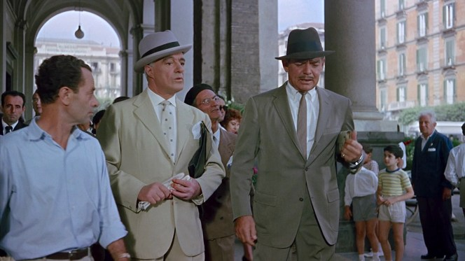 The dapper duo of De Sica and Gable walk the Neapolitan streets in their Neapolitan suits... or at least De Sica wears a confirmed Neapolitan product, Gable still appears to be clad in his American-made duds.