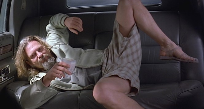 """Hey, careful, man, there's a beverage here!"" The Dude cautiously balances his White Russian as he's tossed into the back of a limo."