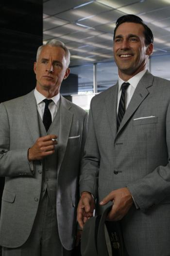 "John Slattery and Jon Hamm in ""Red in the Face"", Episode 1.07 of Mad Men. Note the clear gold stenciling of ""Stetson"" on the leather band of the gray trilby in Don's left hand."