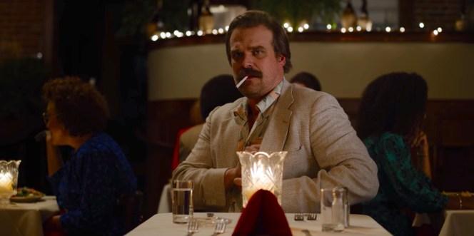 Dressed for date night, Hopper lights a cigarette as he awaits Joyce's arrival.