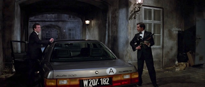 Still armed with his Walther WA 2000, Bond takes charge, immediately dismissing Saunders' suggestion of attempting to smuggle Koskov in the trunk of his Audi.