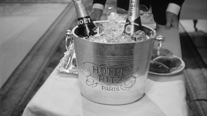 Yet another bucket of chilled Moët makes its way to Frank and his latest date.