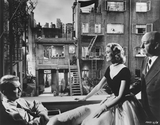 Alfred Hitchcock joins James Stewart and Grace Kelly on the set of Jeff's apartment, overlooking the courtyard set.