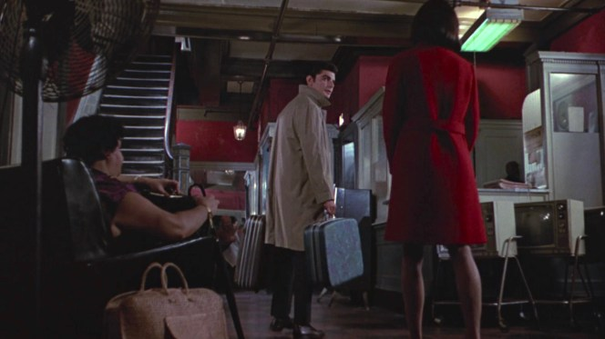 The raincoat-clad Neil may see himself as a Rick Blaine or Philip Marlowe-type as he checks into a hotel with Brenda using an assumed name... but his love story is about to take an ignominious downturn as opposed to the epic, world-saving panache of Rick and Ilsa.