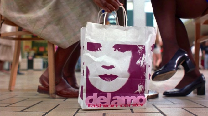 Jackie's black pumps get prominent screen time during an earlier scene opposite Sharonda in the Del Amo food court, with a guest appearance from the shopping bag that serves as Jackie's only viable competition for Ray Nicolette's affections.