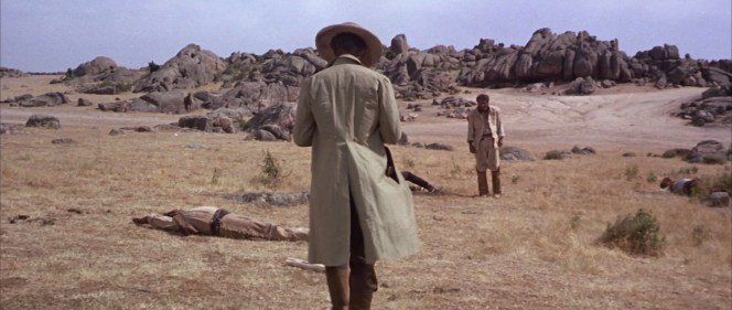 As Blondie approaches Tuco in their shared introductory scene, note the butt of Blondie's holstered revolver jutting through the slit in the right side of his frock coat.