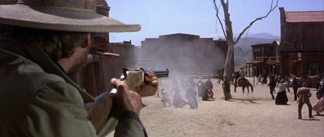Note the loading gate on the right side of the brass receiver, indicating that Blondie's rifle is the anachronistic Winchester Model 1866. You can also see the top of his side-mounted scope as he takes careful aim to cut down Tuco's rope.