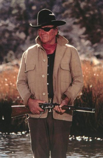 Production photo of John Wayne with his well-traveled Winchester in True Grit